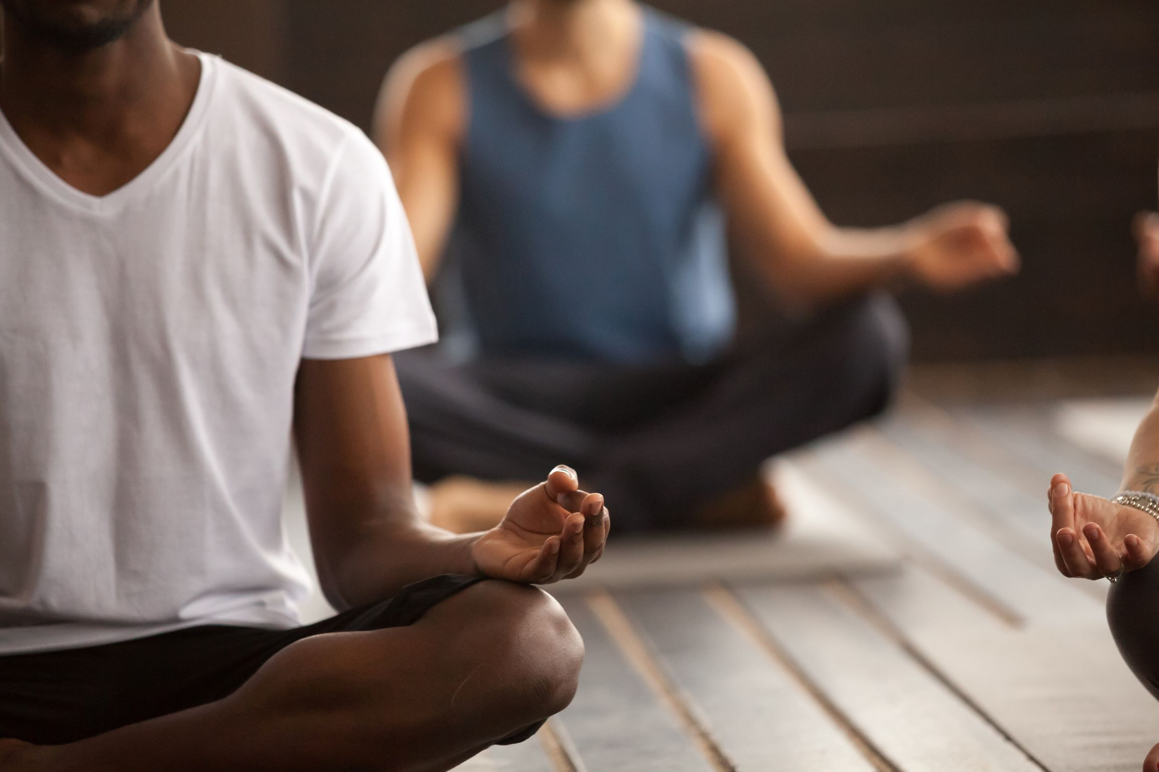 men combatting stress with yoga