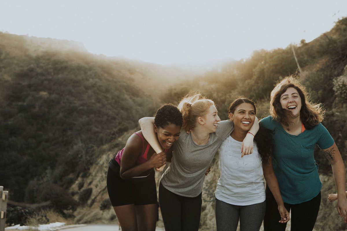 Group of women laughing outdoors