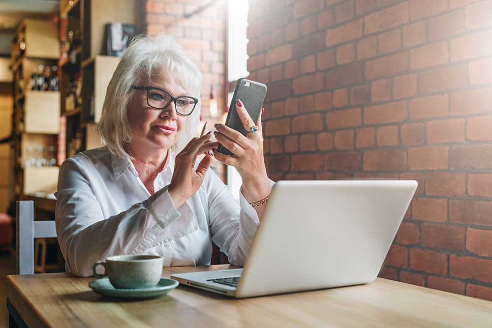 woman-reviewing-her-pension-pots-in-a-cafe