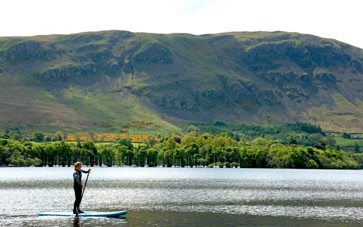 Woman Stand Up Paddle Boarding in Lake District