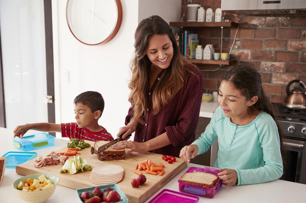 Mom and kids preparing food