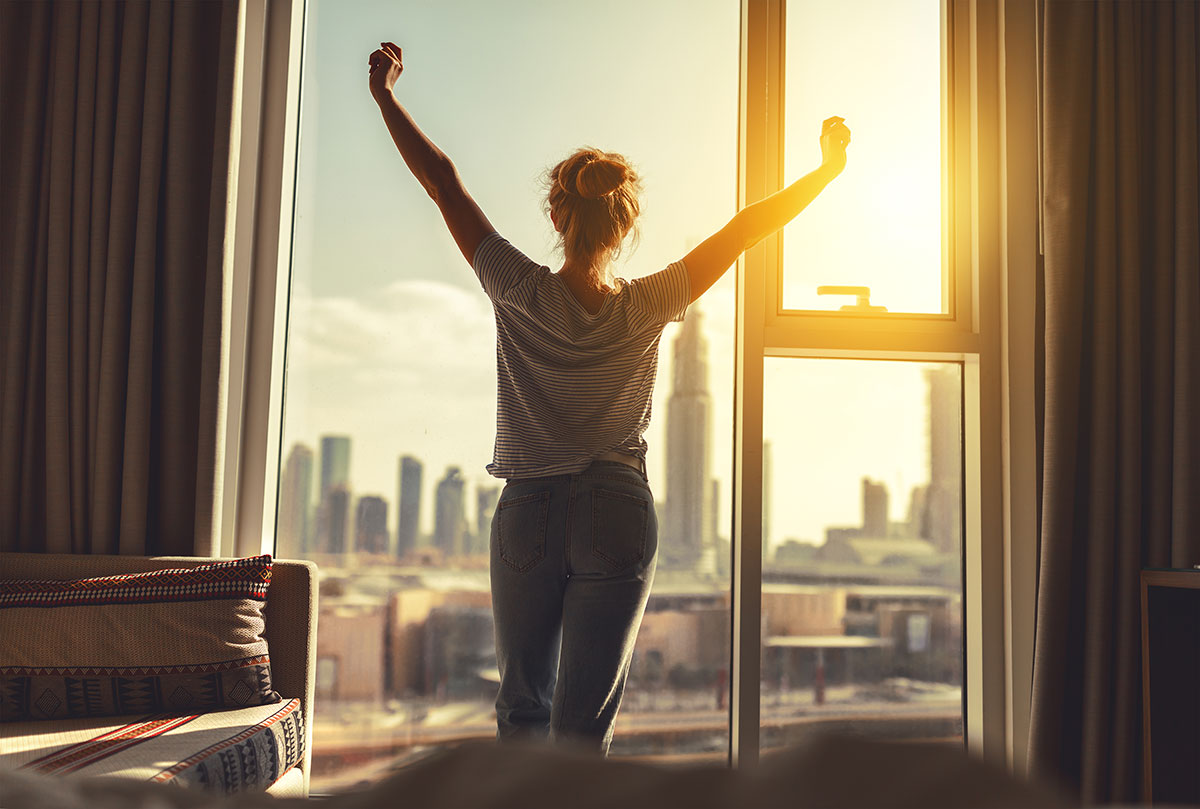 Woman stretching during sunrise