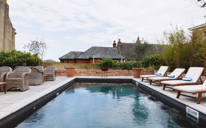 Pool and sunloungers at North House in Cowes