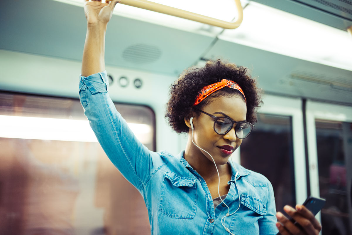 Woman listening to podcast on train