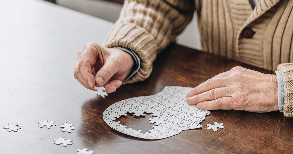 older person doing a puzzle
