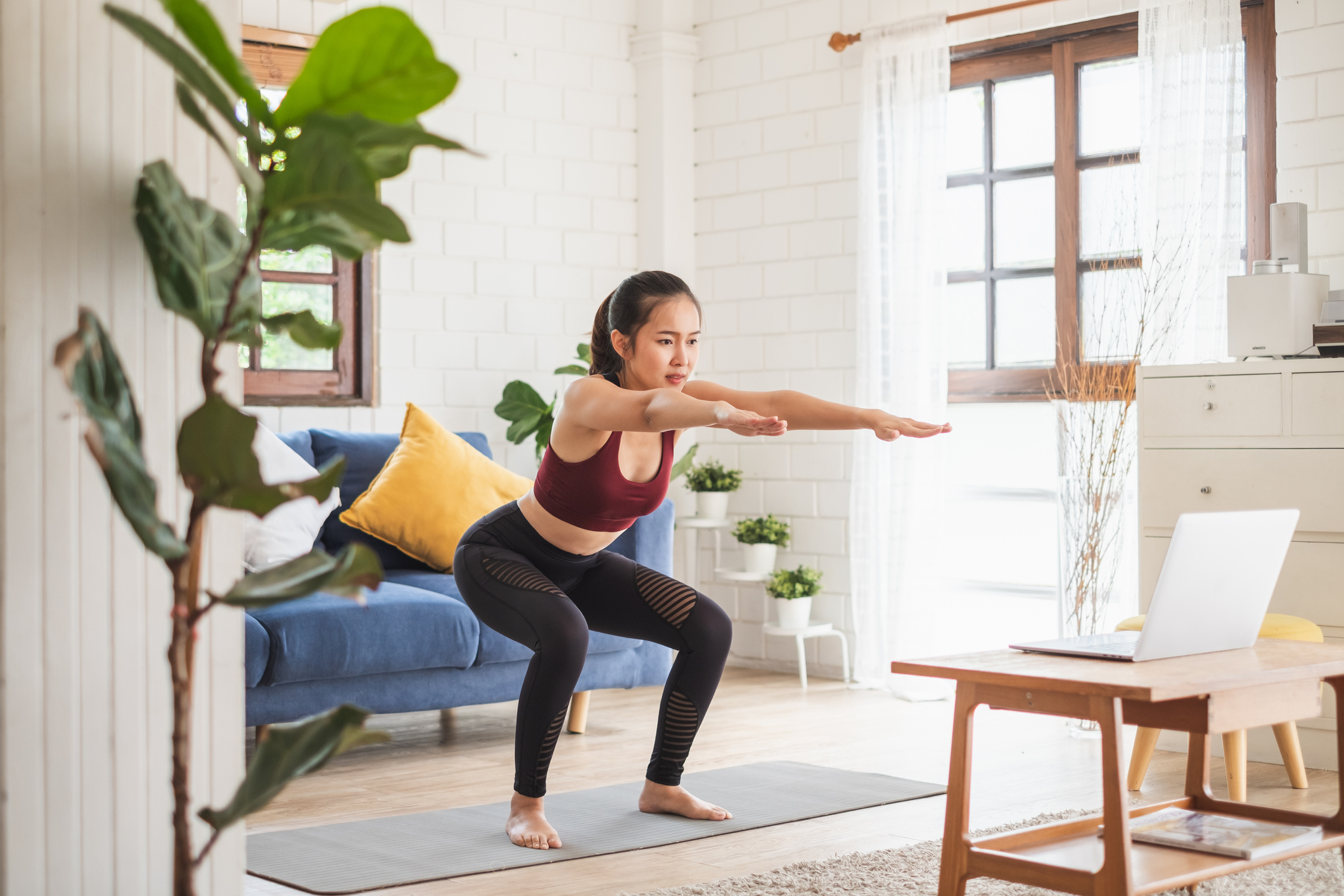 Woman doing a HIIT workout at home