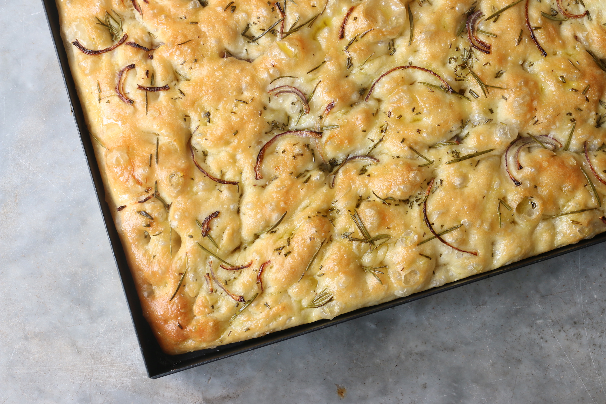 Baked healthy bread rosemary and red onion focaccia