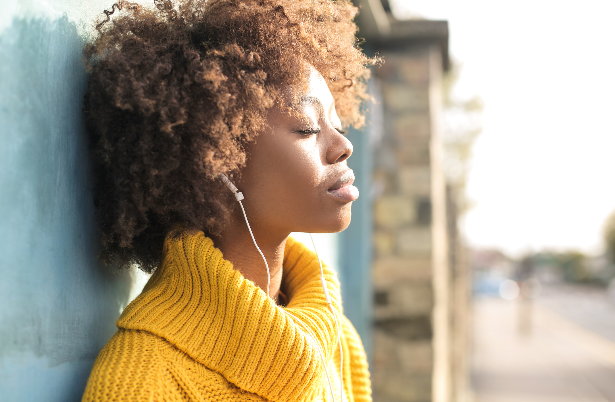 Woman listening to music to stay calm with anxiety