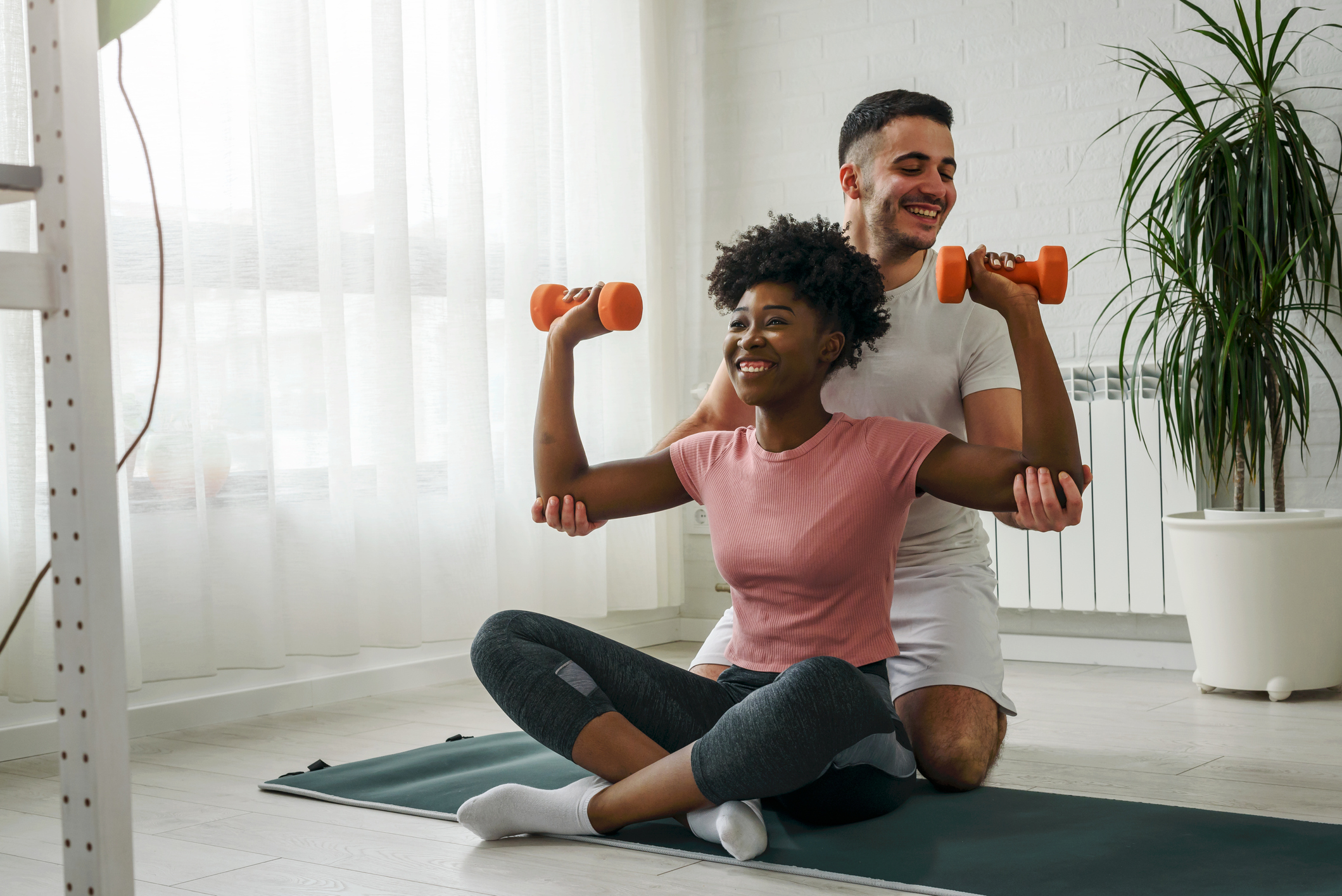 healthy couple doing physical activity at home