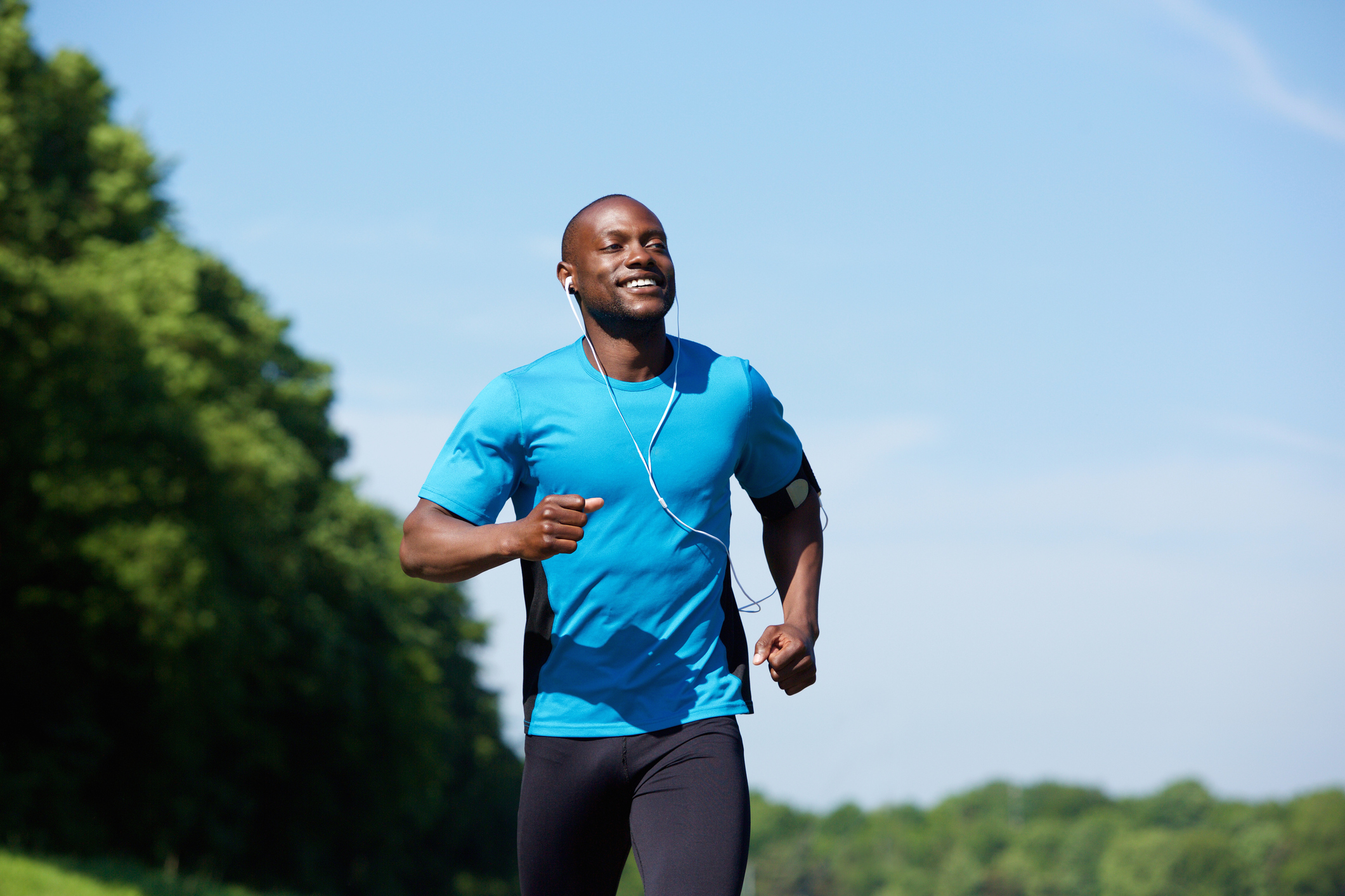 Black man exercising outdoors in the park