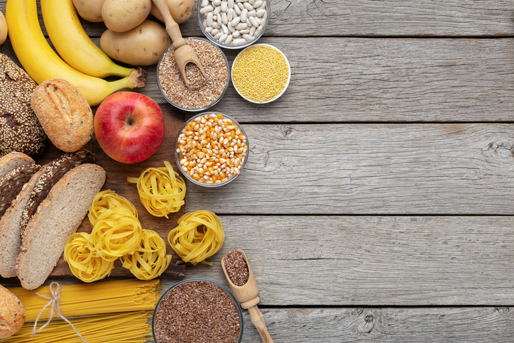 Group of wholegrain and carbohydrates food on wood