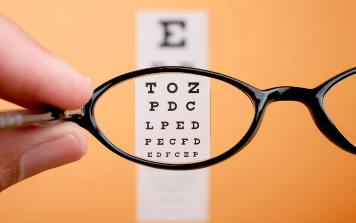 Looking at an eye test chart through glasses