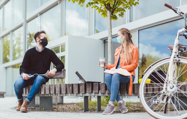 Man and woman social distancing