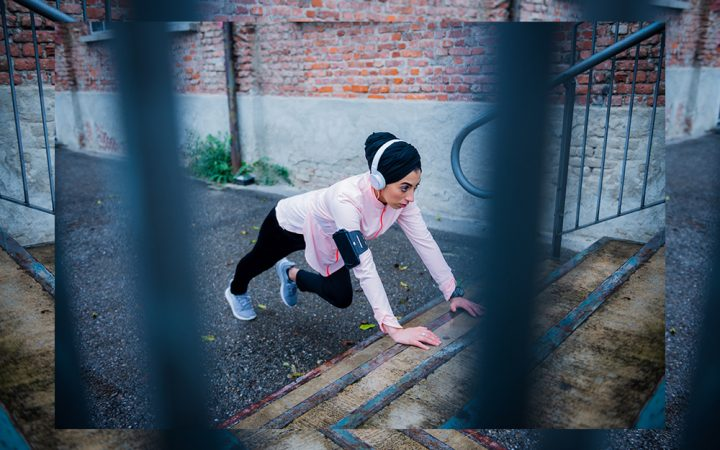 Woman doing pushups on steps