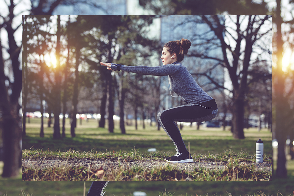 Woman doing squats in the park