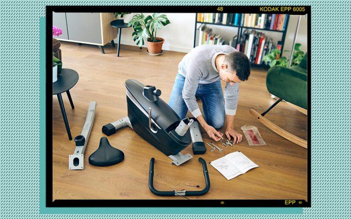 Man assembling a home workout bike