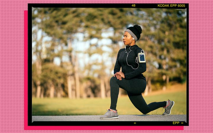 Woman exercising with a fitness tracker
