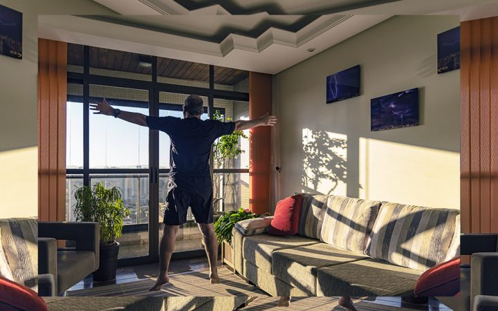 Man exercising in a living room
