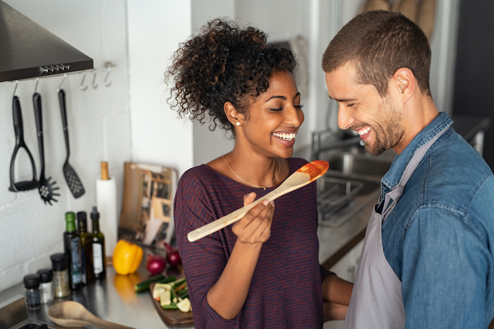 Couple trying a new recipe at home