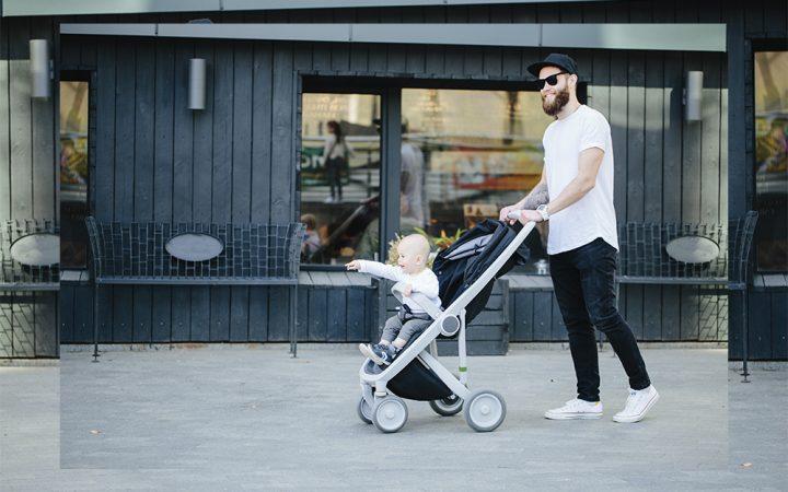 Man pushing child in a pram