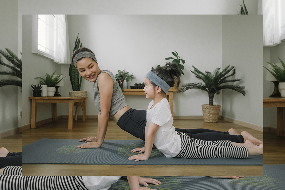 A mother and daughter doing a family fitness activity