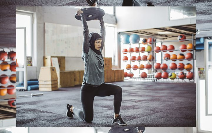 Woman squat pressing weighted plate