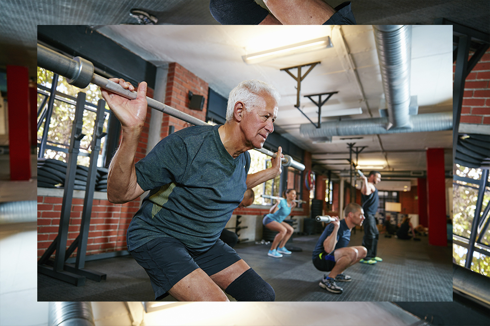 Elderly man lifting weights at the gym