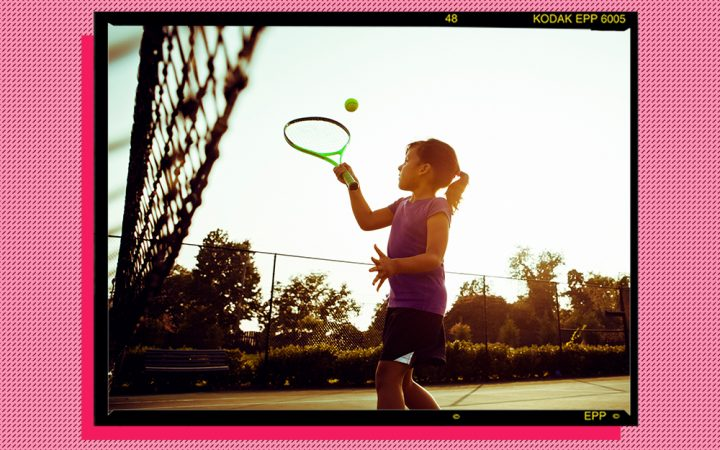 Girl playing tennis outdoors