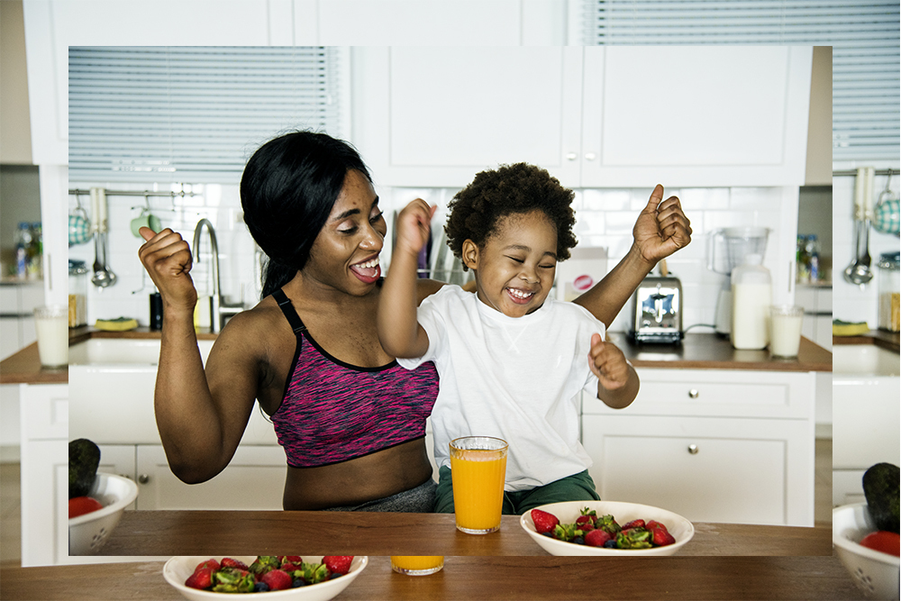 Image of woman and child looking happy eating