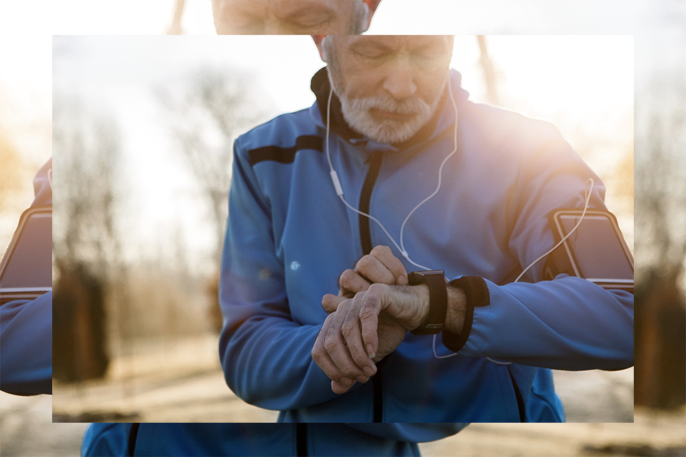 Image of man checking a fitness tracker