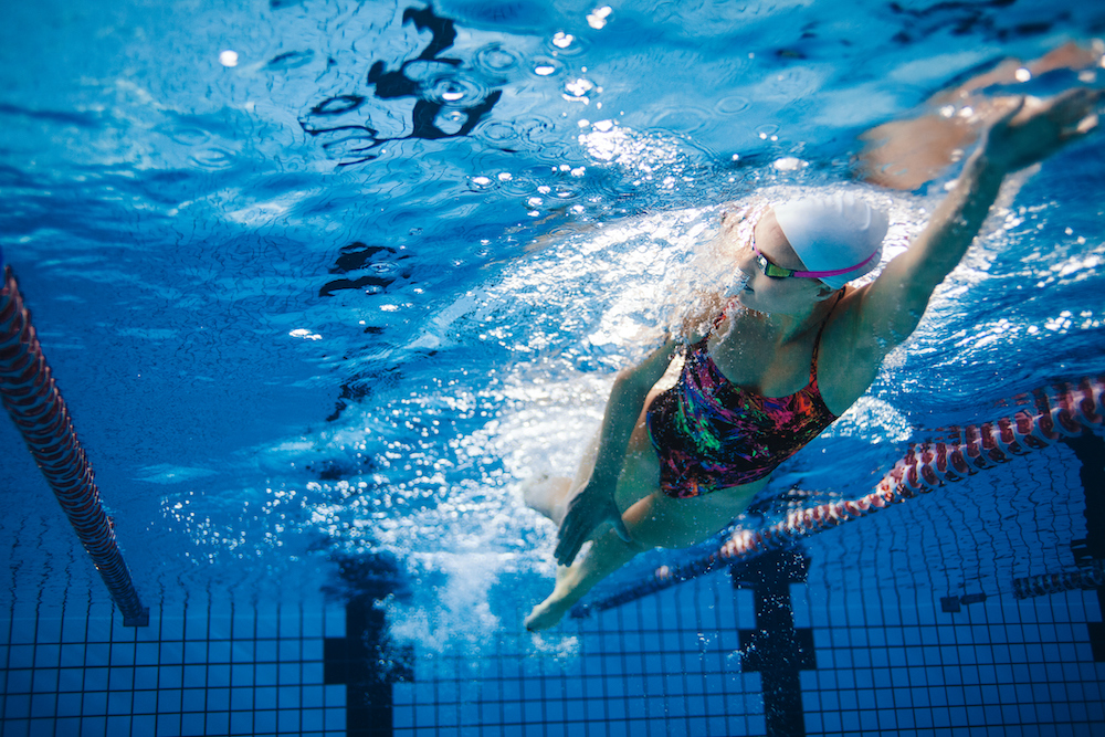 woman practicing swimming routine