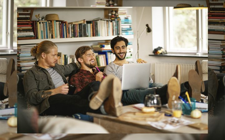 Friends at home laughing to socialise together