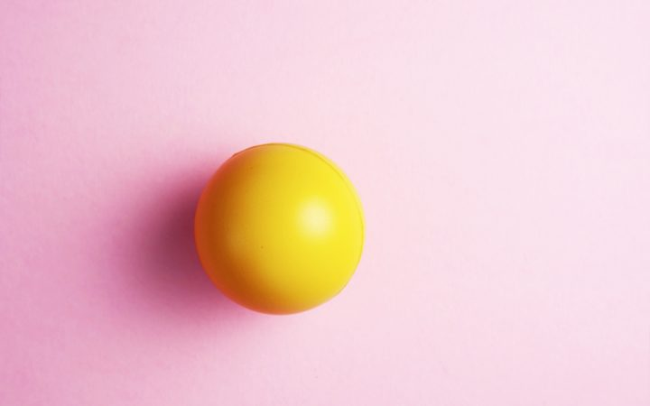 Yellow stress ball for managing stress to help with IBS symptoms