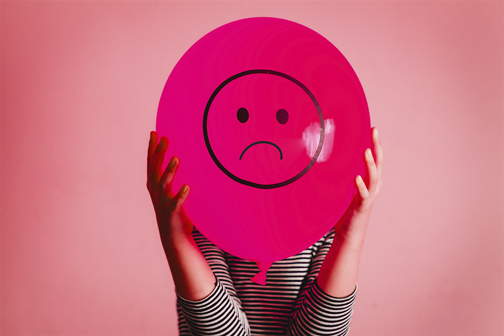 Balloon with a sad face on regarding IBS