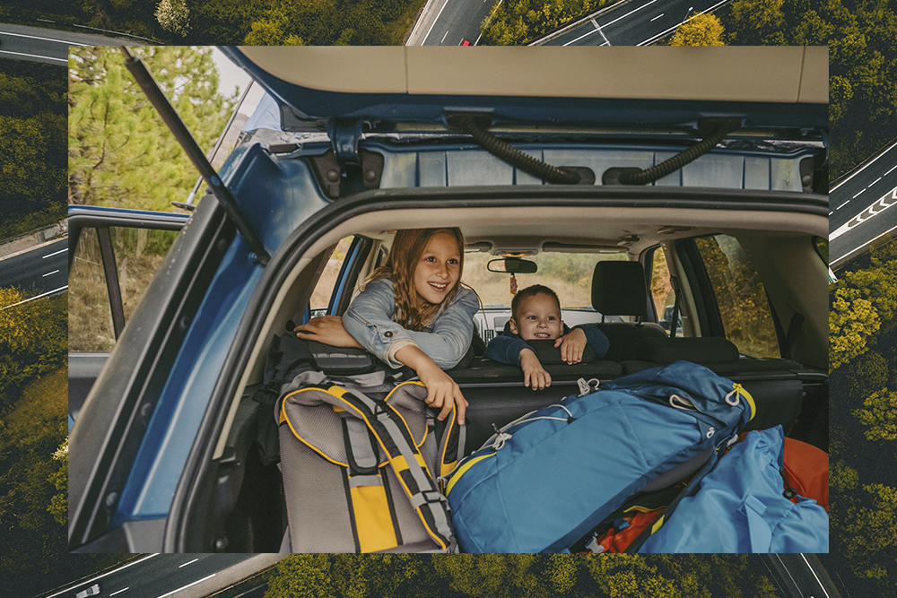 two kids looking entertained in a car