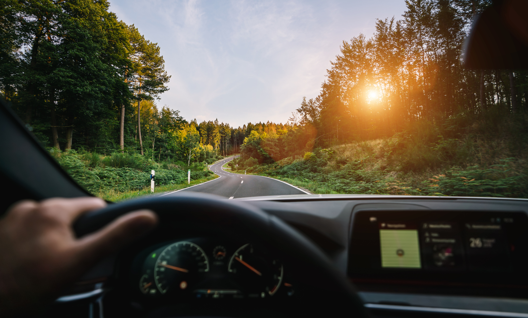 Person driving with open mind on an open road