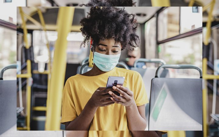 Woman commuting to work on the bus wearing a facemask