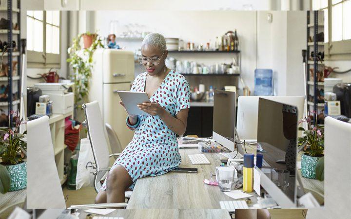 Woman at work wearing a light blue dress