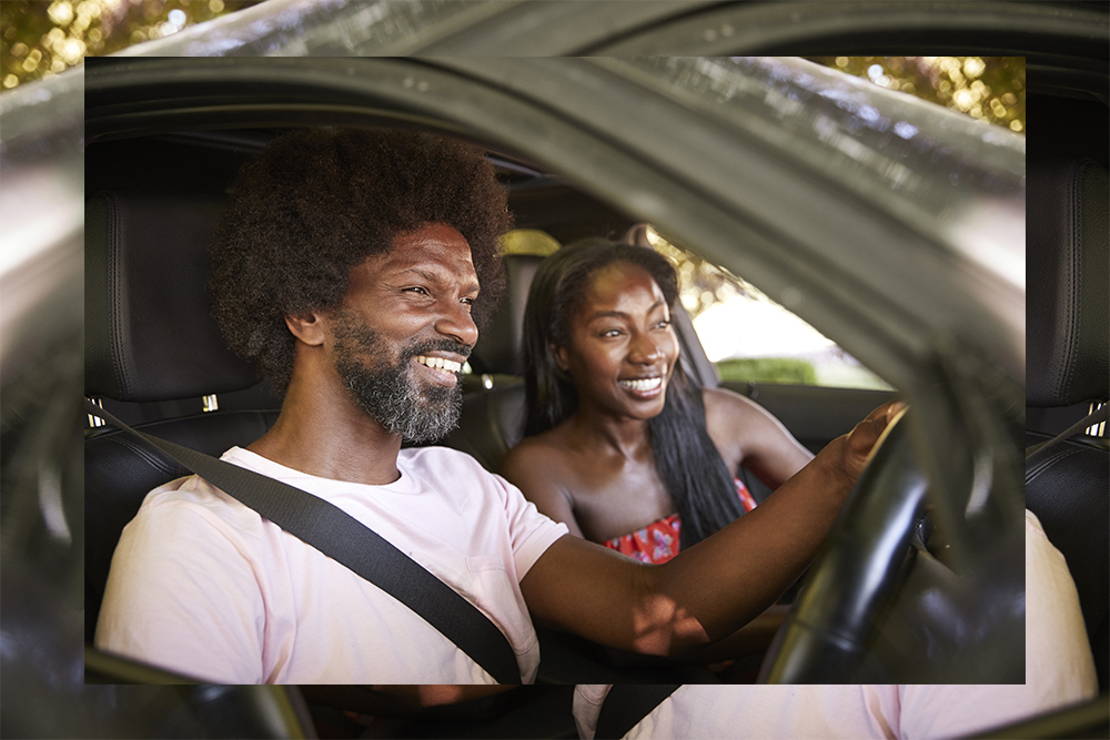 Family in car smiling and laughing