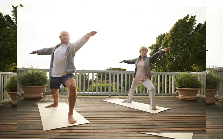Elderly couple doing yoga together
