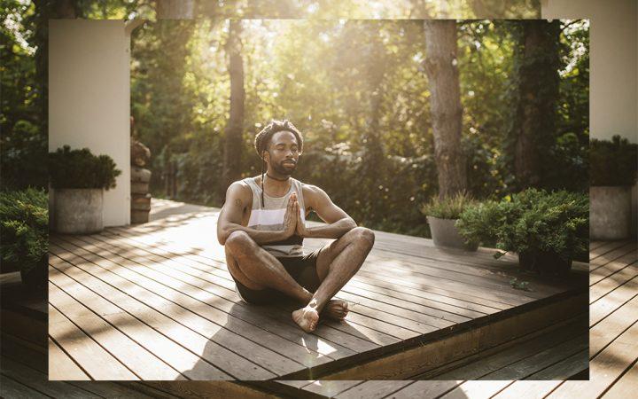 Man outside in the sunshine doing yoga