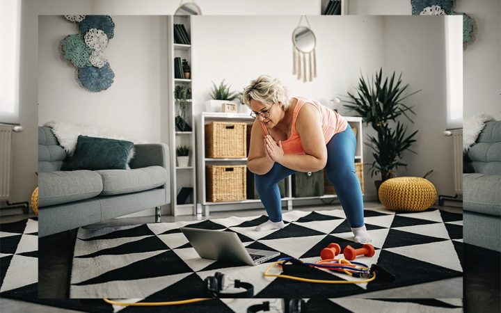 Woman in living room stretching her body