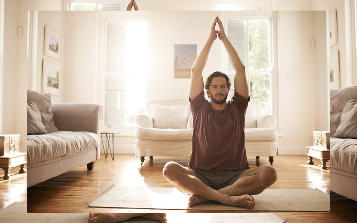 Man doing daily yoga at home in his house