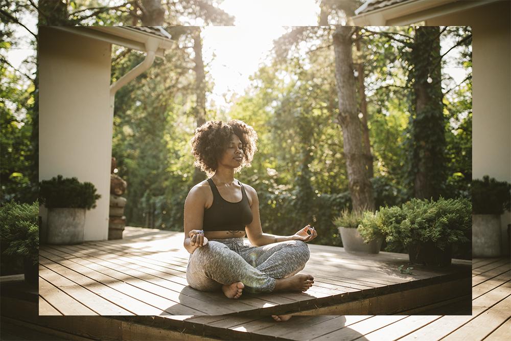 Woman in garden practicing yoga