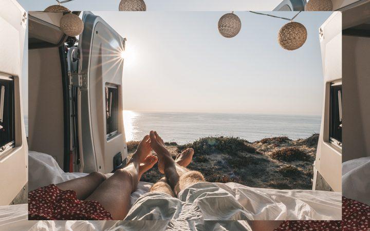 two people in a van at the seaside