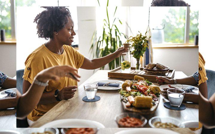 Woman at dinner table eating vegan food