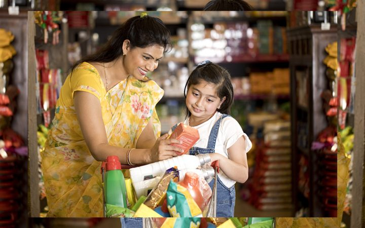 Woman and child reading back of food packet