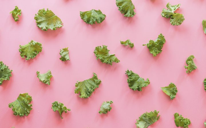 Picture of lettuce on a pink background