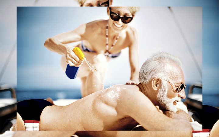 Older man and woman on beach in the sun