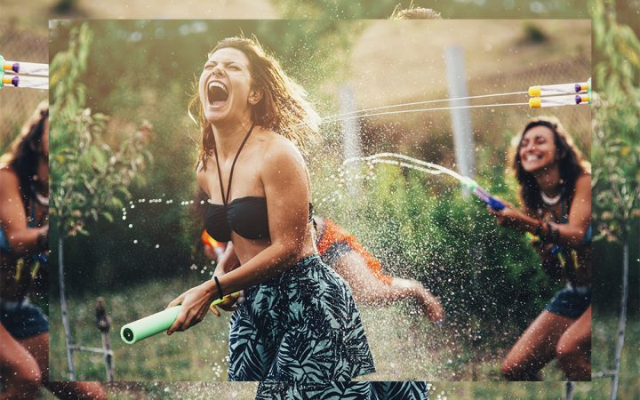 Woman and friends in garden laughing in water